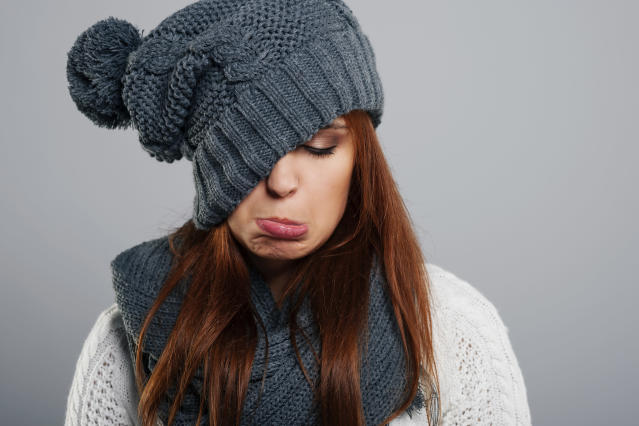 Young woman doesn't like winter time