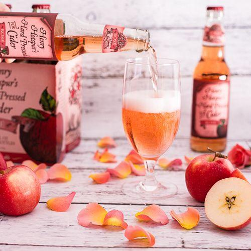 """<p>Get excited! Trader Joe's has released its own rosé hard cider, Henry Hotspur's Rosé Cider. Each bottle of the pink drink has 5.8% ABV (<a href=""""https://www.bestproducts.com/lifestyle/a22103905/angry-orchard-rose-cider-partners-with-daveys-ice-cream-in-nyc/"""" rel=""""nofollow noopener"""" target=""""_blank"""" data-ylk=""""slk:Angry Orchard Rosé Cider"""" class=""""link rapid-noclick-resp"""">Angry Orchard Rosé Cider</a> has 5.5%). The price tag is sitting pretty at $7.99 for a pack of six.</p>"""