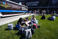 Fans picnic behind the stands before the start the Indianapolis 500 auto race at Indianapolis Motor Speedway in Indianapolis, Sunday, May 30, 2021. (AP Photo/Darron Cummings)