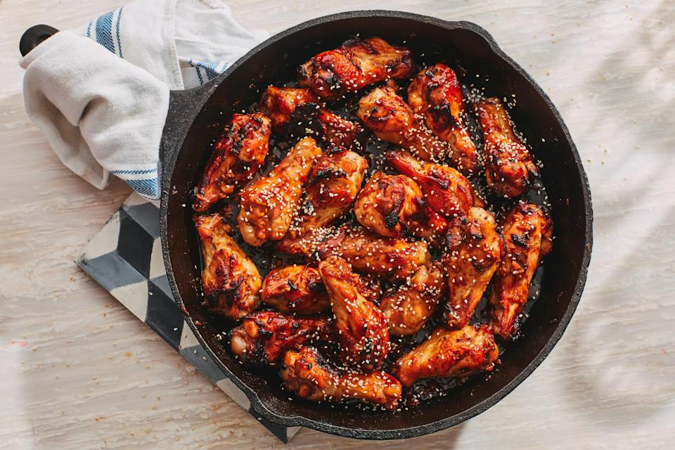 "Chicken wing drumettes are the sort of hearty appetizers that you can absolutely consider just a starter—or a complete dinner. These are cooked with sherry, fresh ginger, soy sauce, honey, garlic, and sesame oil. <a href=""https://www.epicurious.com/recipes/food/views/sesame-chicken-drumettes-33?mbid=synd_yahoo_rss"" rel=""nofollow noopener"" target=""_blank"" data-ylk=""slk:See recipe."" class=""link rapid-noclick-resp"">See recipe.</a>"
