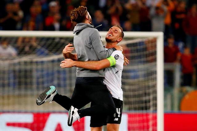 Soccer Football - Champions League Semi Final Second Leg - AS Roma v Liverpool - Stadio Olimpico, Rome, Italy - May 2, 2018 Liverpool's Adam Lallana celebrates with Jordan Henderson after the match REUTERS/Tony Gentile