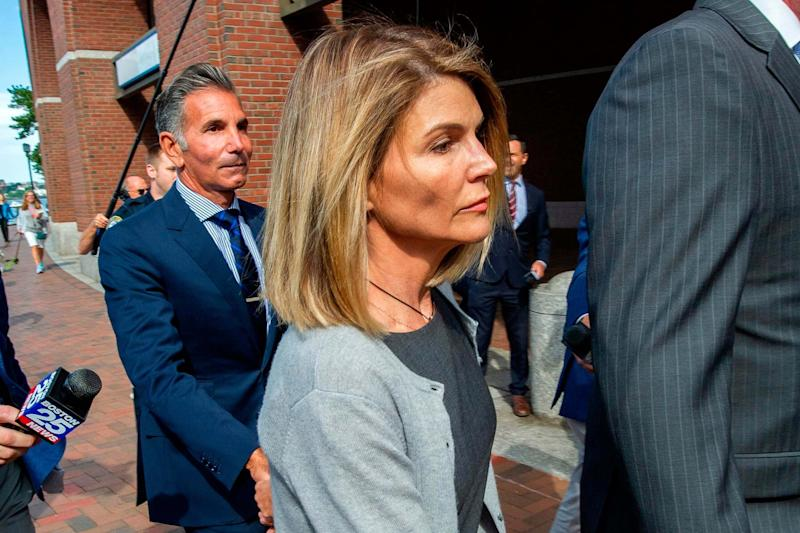 Lori Loughlin and husband Mossimo Giannulli (AFP via Getty Images)