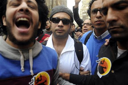 Ahmed Maher (C), founder of the April 6 movement, turns himself in at Abdeen court in Cairo November 30, 2013. REUTERS/Stringer
