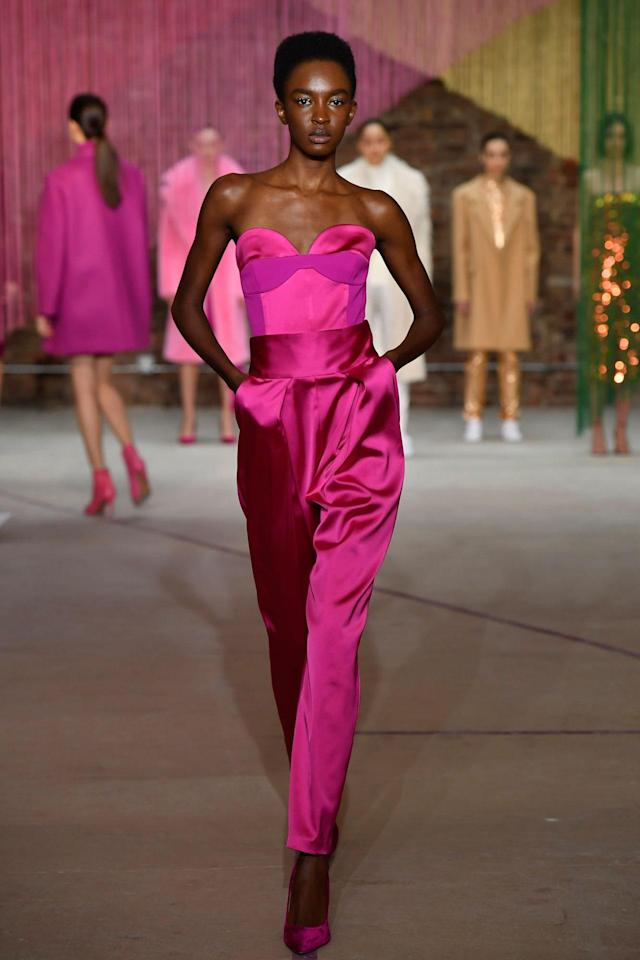 <p>Model wears a fuchsia evening jumpsuit at the Milly Fall/Winter 2018 show. (Photo: Courtesy of Greg Kessler) </p>
