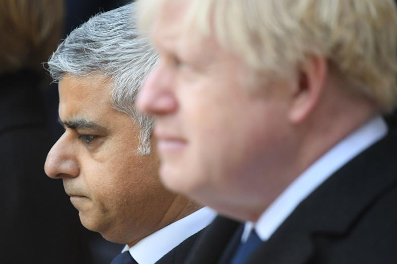 London mayor Sadiq Khan (L) and Britain's Prime Minister Boris Johnson take part in a vigil at the Guildhall in central London to pay tribute to the victims of the London Bridge terror attack on December 2, 2019. (Photo by DANIEL LEAL-OLIVAS / AFP) (Photo by DANIEL LEAL-OLIVAS/AFP via Getty Images)