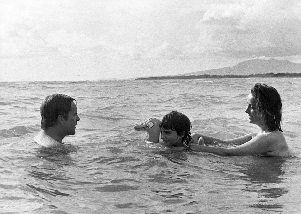 <p>Richard Burton, his wife, Elizabeth Taylor, and his stepdaughter, Liza Todd, go for a dip in the ocean while in Mexico for his film, <em>Night of the Iguana, </em>in 1963. </p>