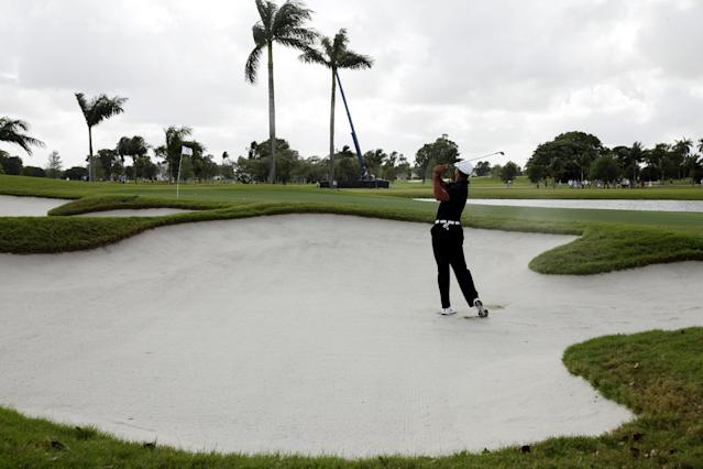 Tiger Woods hits out of an 8th-hole sand trap during the first round of the Cadillac Championship golf tournament, Thursday, March 8, 2012, in Doral, Fla. (AP Photo/Wilfredo Lee)