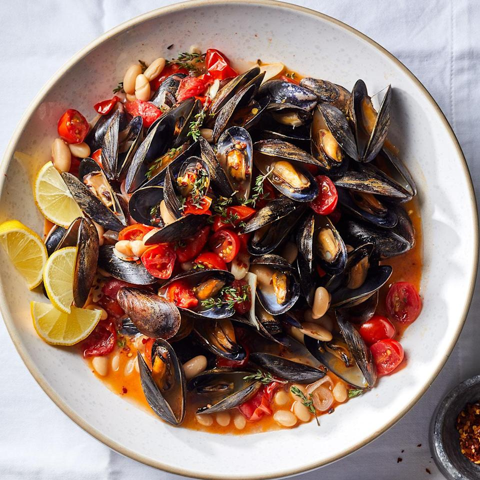 <p>Cooking mussels may seem intimidating, but here we've made it quick and easy. We've added white beans to turn this classic mussels-in-white-wine-sauce dish into a heartier weeknight meal. Serve with whole-grain crusty bread to sop up the flavorful broth.</p>