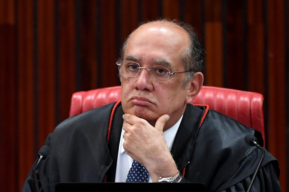 Supreme Electoral Court President (TSE) Judge Gilmar Mendes attends the session examining whether the 2014 reelection of president Dilma Rousseff and her then-vice president Michel Temer should be invalidated because of corrupt campaign funding, in Brasilia, on June 8, 2017.  Judges on Brazil's electoral court were expected to start voting on the eve, in a case that could topple scandal-tainted President Michel Temer. If the court votes to scrap the election result, Temer -- who took over only last year when Rousseff was impeached -- would himself risk losing his office, forcing Brazil's congress to pick an interim president. / AFP PHOTO / EVARISTO SA        (Photo credit should read EVARISTO SA/AFP via Getty Images)