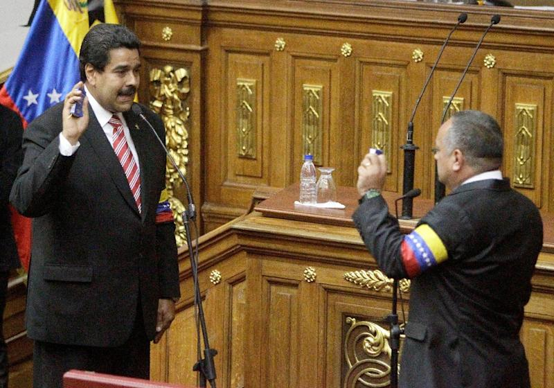 Nicolas Maduro takes the presidential oath from  National Assembly's President Disodado Cabello during a swearing-in ceremony at the National Assembly in Caracas, Venezuela, Friday, March 8, 2013. Maduro was sworn in Friday as Venezuela's acting president, against the objections of the political opposition who said the move violated the country's constitution.  Late President Hugo Chavez designated vice-president Maduro as his successor before he died Tuesday of cancer. (AP Photo/Fernando Llano)