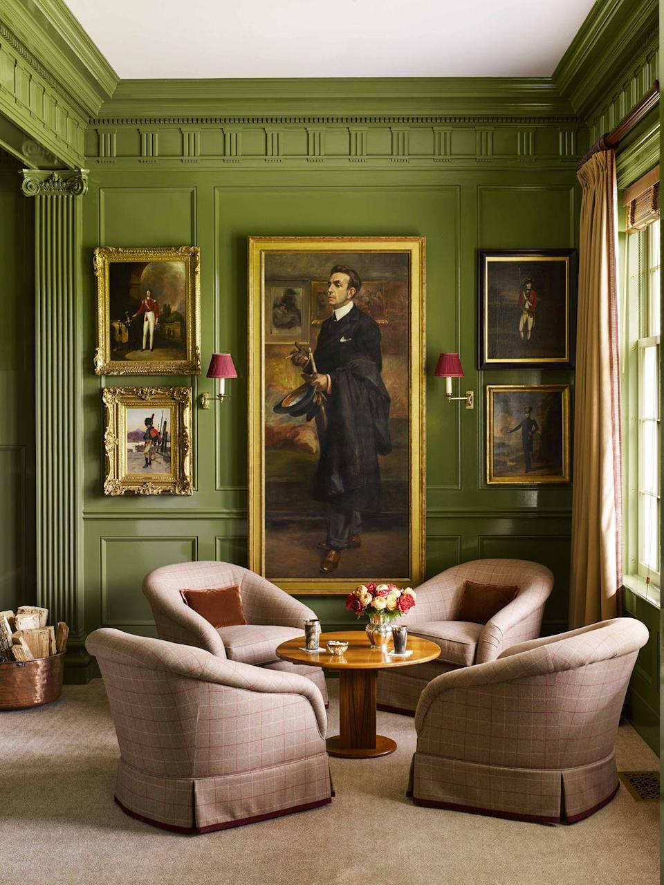 """<p>In the adjoining cocktail lounge, the walls are painted Avocado by <a href=""""https://www.benjaminmoore.com/en-us"""" rel=""""nofollow noopener"""" target=""""_blank"""" data-ylk=""""slk:Benjamin Moore"""" class=""""link rapid-noclick-resp"""">Benjamin Moore</a> in a high gloss finish. An ancient Greek frieze pattern (also seen on the Parthenon in Athens) matches the scale and refinement of a collection of European oil portraits. </p><p><a class=""""link rapid-noclick-resp"""" href=""""https://go.redirectingat.com?id=74968X1596630&url=https%3A%2F%2Fwww.etsy.com%2Flisting%2F584302118%2Fterracotta-velvet-pillow-terracotta%3Fga_order%3Dmost_relevant%26ga_search_type%3Dall%26ga_view_type%3Dgallery%26ga_search_query%3Dterracotta%2Bpillow%26ref%3Dsr_gallery-1-1%26pro%3D1&sref=https%3A%2F%2Fwww.veranda.com%2Fdecorating-ideas%2Fg28837805%2Fhome-bar-ideas%2F"""" rel=""""nofollow noopener"""" target=""""_blank"""" data-ylk=""""slk:Find Similar Velvet Pillows Here"""">Find Similar Velvet Pillows Here</a></p>"""
