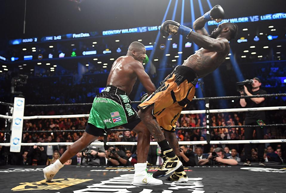 Heavyweight champion Deontay Wilder (R) of the US fights contender Luis Ortiz of Cuba during their WBC heavyweight title fight in New York on March 3, 2018. / AFP PHOTO / Timothy A. CLARY        (Photo credit should read TIMOTHY A. CLARY/AFP via Getty Images)