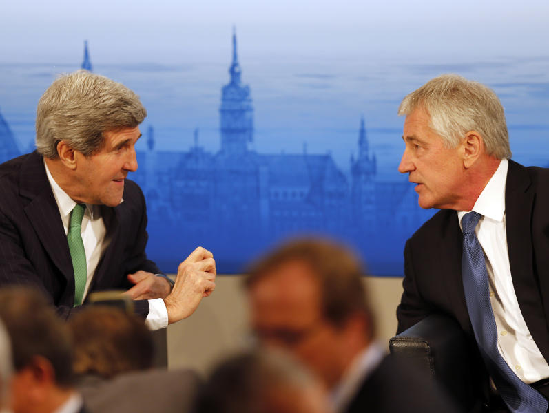 US Secretary of State John Kerry , left, and US Secretary of Defense, Chuck Hagel chat during the 50th Security Conference in Munich, Germany, Saturday, Feb. 1, 2014. The conference on security policy takes place from Jan.31,2014 until Feb. 2, 2014. (AP Photo/Frank Augstein)