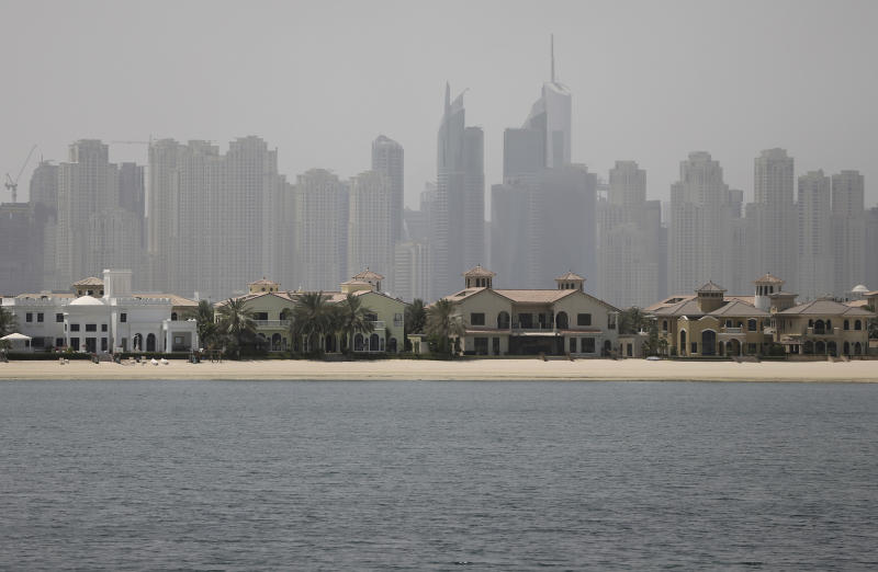FILE - In this June 6, 2018 file photo, Jumeirah Palm Island luxury villas are seen by their private beaches in Dubai, United Arab Emirates. Dubai's ruler has issued a directive to curb the pace of new real estate construction projects amid falling demand and property prices. On Monday, Sept. 2, 2019, Sheikh Mohammed bin Rashid Al Maktoum ordered the creation of a committee to study the needs of the real estate market, evaluate all future projects and control the pace of projects so supply does not outstrip demand. (AP Photo/Kamran Jebreili, File)
