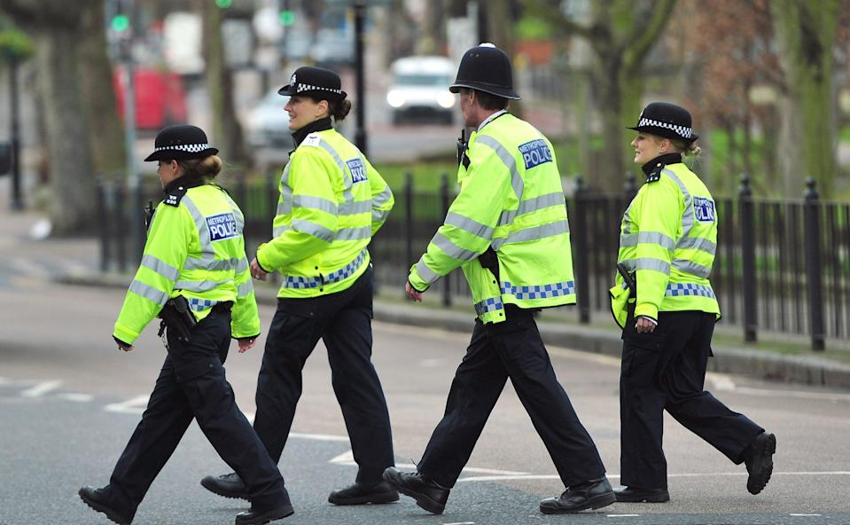 Stock image: Most assaults, with or without injury, took place on officers in London as the Met recorded 6,419 incidents (PA Archive)