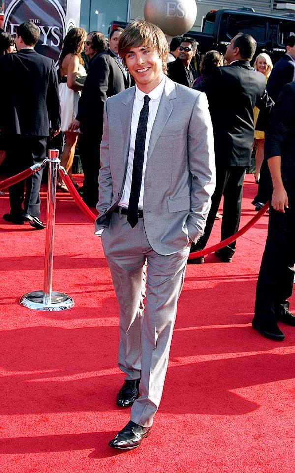 "Teen heartthrob Zac Efron lit up the red carpet in his gray suit, skinny black tie, and beautiful smile. Jeffrey Mayer/<a href=""http://www.wireimage.com"" target=""new"">WireImage.com</a> - July 16, 2008"