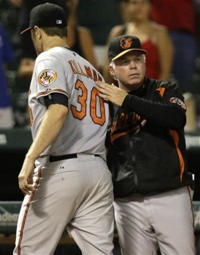 Baltimore Orioles starting pitcher Chris Tillman (30) gets a pat from manager Buck Showalter (26) after the baseball game against the Texas Rangers on Sunday, July 21, 2013, in Arlington, Texas. Tillman pitches eight innings, giving up two runs, as the Orioles won 4-2. (AP Photo/LM Otero)