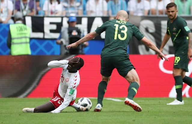 Soccer Football - World Cup - Group C - Denmark vs Australia - Samara Arena, Samara, Russia - June 21, 2018 Denmark's Pione Sisto reacts after a challenge from Australia's Aaron Mooy REUTERS/Pilar Olivares