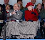 <p>Prince Philip and the queen share a blanket at the Braemar Gathering in Scotland. </p>