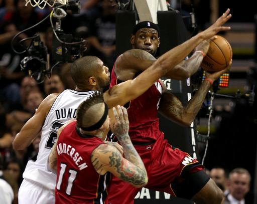 SAN ANTONIO, TX - JUNE 11: LeBron James #6 of the Miami Heat looks to pass against Tim Duncan #21 of the San Antonio Spurs in the first quarter during Game Three of the 2013 NBA Finals at the AT&T Center on June 11, 2013 in San Antonio, Texas. (Photo by Mike Ehrmann/Getty Images)