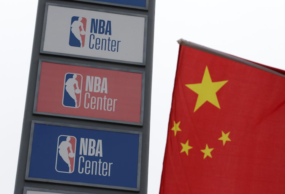NBA logos are seen next to a Chinese national flag outside a NBA-themed lifestyle complex on the outskirts of Tianjin, China, October 10, 2019. REUTERS/Jason Lee
