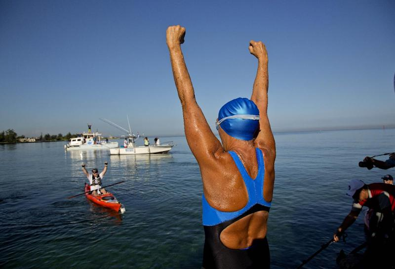 U.S. swimmer Diana Nyad, 64, greets her support team before her swim to Florida from Havana, Cuba, Saturday, Aug. 31, 2013. Endurance athlete Nyad launched another bid Saturday to set an open-water record by swimming from Havana to the Florida Keys without a protective shark cage. (AP Photo/Ramon Espinosa)