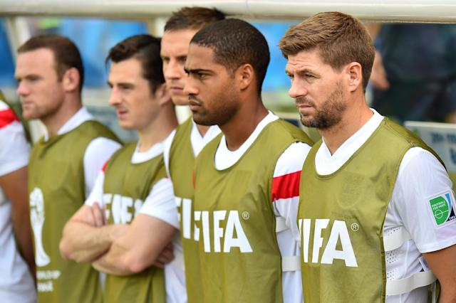 England's captain Steven Gerrard (R) stands with substitutes during their Group D match against Costa Rica, at The Mineirao Stadium in Belo Horizonte, Brazil, during the FIFA World Cup, on June 24, 2014 (AFP Photo/Ben Stansall)