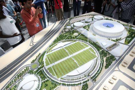 People look at a model of Al Thumama stadium during an unveiling ceremony at Hamad International Airport in Doha, Qatar, August 24, 2017. REUTERS/Naseem Zeitoon