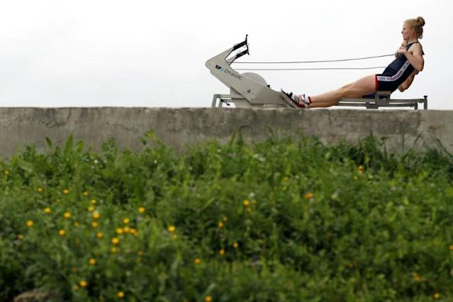 British rower Polly Swann is put through her paces at a training camp in Portugal (AFP Photo/ADRIAN DENNIS)