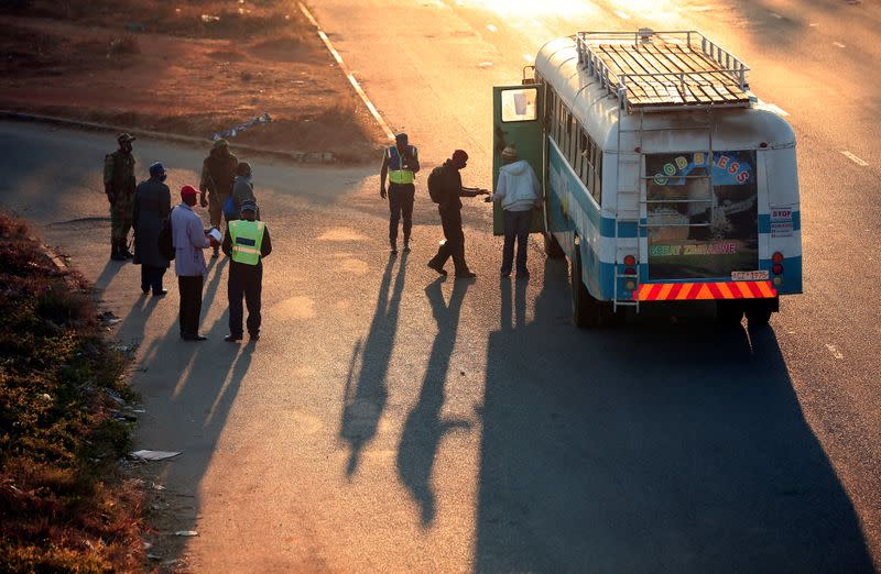 Police check bus passengers ahead of planned anti-government protests in Harare