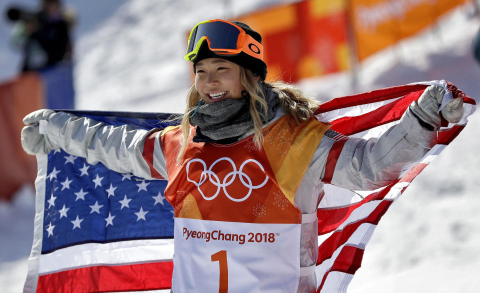 Chloe Kim celebrates winning gold after the women's halfpipe finals at Phoenix Snow Park at the 2018 Winter Olympics in Pyeongchang, South Korea. (AP)