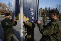 Members of Kosovo's Security Forces are lined up during the flag raising ceremony in this southeastern town of Gjilan, Kosovo on Thursday, Dec. 13, 2018, a day before the parliament votes to transform them into a regular army. Kosovo lawmakers are set to transform the Kosovo Security Force into a regular army, a move that significantly heightened tension with neighboring Serbia which even left open a possibility of an armed intervention in its former province. (AP Photo/Visar Kryeziu)