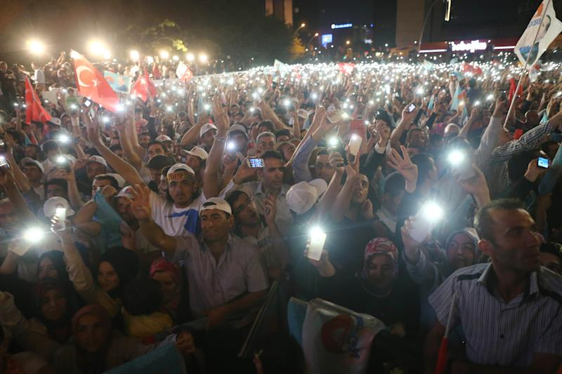 Supporters of newly elected Turkish president Recep Tayyip Erdogan hold their smartphones as they listen to his speech during the celebrations of his victory in Ankara on August 10, 2014 (AFP Photo/Adem Altan)