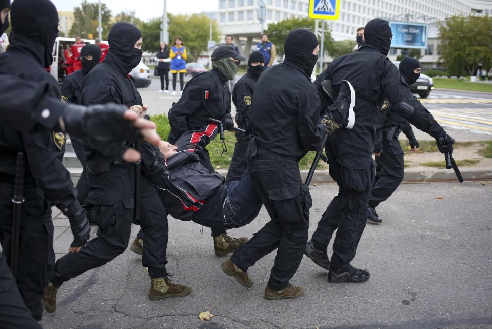 Police detain a demonstrator during an opposition rally to protest the official presidential election results in Minsk, Belarus, Sunday, Sept. 27, 2020.Hundreds of thousands of Belarusians have been protesting daily since the Aug. 9 presidential election. (AP Photo/TUT.by)