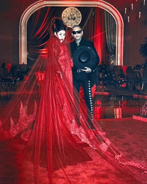 "<p>For their ultimate gothic ceremony - of course - Kat Von D and Rafael Reyes, aka Leafar Seyer, wed in front of friends and family all dressed in black. The bride however, wore a vibrant red statement dress with matching epic veil and horns in her hair. </p><p><a href=""https://www.instagram.com/p/B4wcR22lwtO/"" rel=""nofollow noopener"" target=""_blank"" data-ylk=""slk:See the original post on Instagram"" class=""link rapid-noclick-resp"">See the original post on Instagram</a></p>"