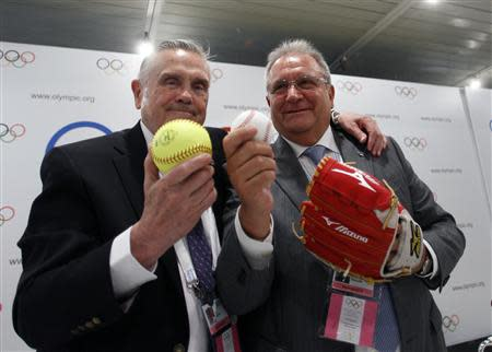 Fraccari, President of the International Baseball Federation and Porter, president of the International Softball Federation, pose after a news conference in Buenos Aires