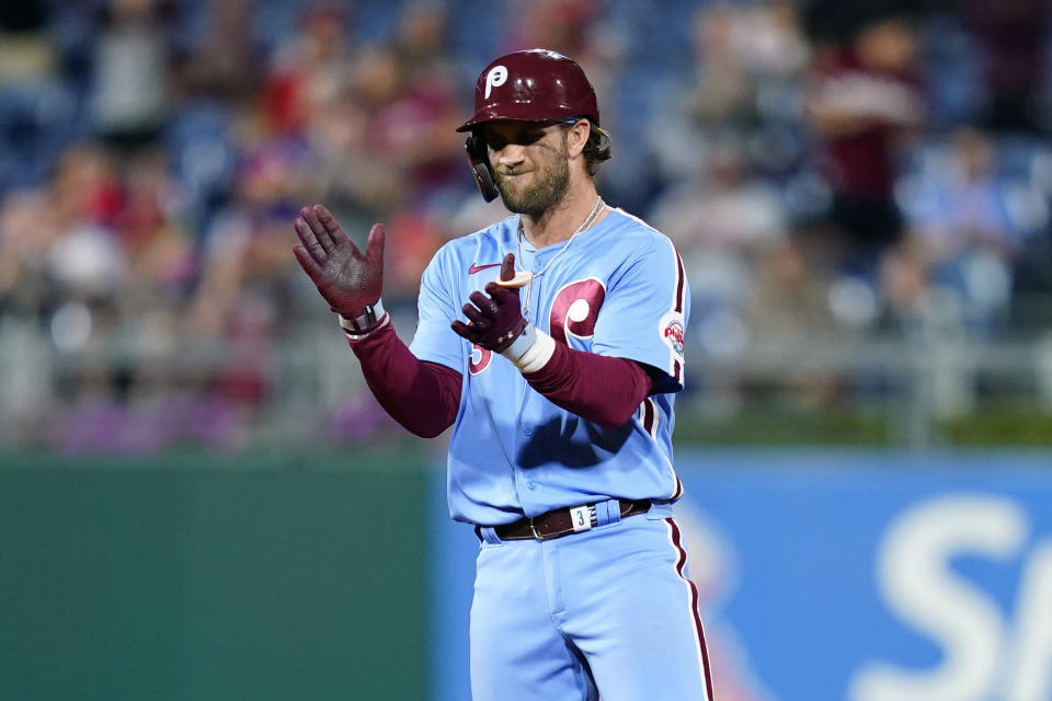 Philadelphia Phillies' Bryce Harper reacts after hitting an RBI-double against Chicago Cubs pitcher Manuel Rodriguez during the sixth inning of a baseball game, Thursday, Sept. 16, 2021, in Philadelphia. (AP Photo/Matt Slocum)