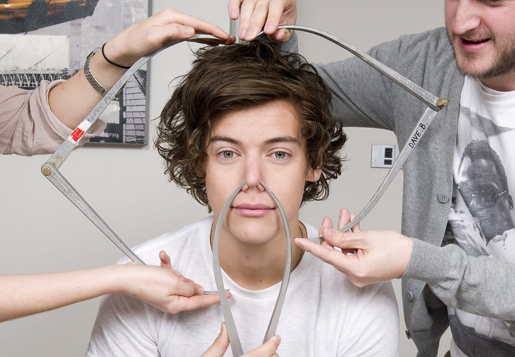 UNSPECIFIED LOCATION - UNSPECIFIED DATE:  In this handout image provided by Madame Tussauds, Harry Styles of One Direction poses with calipers during a figure sitting where he is measured for a wax figure creation.  Madame Tussauds announced March 11, 2013 that the world famous wax attraction will immortalize the band by creating five individual wax figures of each member.  The figures are being created in full cooperation with the band and will be part of a traveling exhibit that will launch in London on April 18 before traveling to New York, July 19 - October 11, and Sydney, October 24 - January 28.  (Photo by Madame Tussauds via Getty Images)