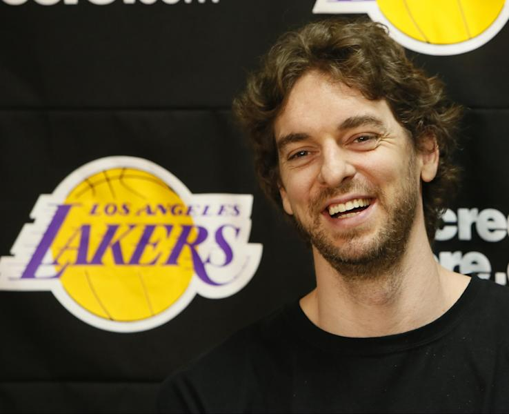 FILE - In this April 30, 2013 file photo, Los Angeles Lakers power forward Pau Gasol smiles while talking to reporters during an NBA basketball news conference in El Segundo, Calif. Gasol spent the past few seasons changing his game to accommodate Andrew Bynum and Dwight Howard. Now that both centers have left Los Angeles, the Spanish 7-footer is eager to resume his role as the Lakers' man in the middle. (AP Photo/Damian Dovarganes, File)