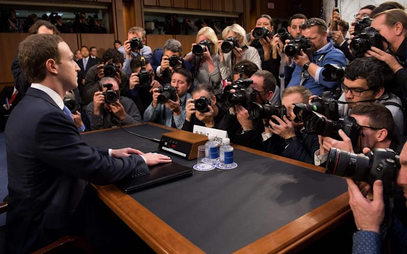 Facebook founder and CEO Mark Zuckerberg arrives to testify during a Senate Commerce, Science and Transportation Committee and Senate Judiciary Committee joint hearing about Facebook on Capitol Hill in Washington. - AFP