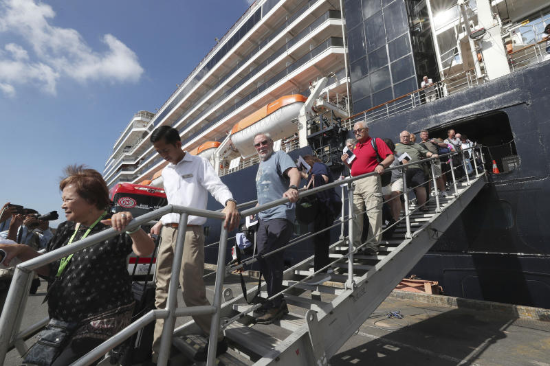 Passengers of the MS Westerdam disembark at the port of Sihanoukville, Cambodia. (AP Photo/Heng Sinith)