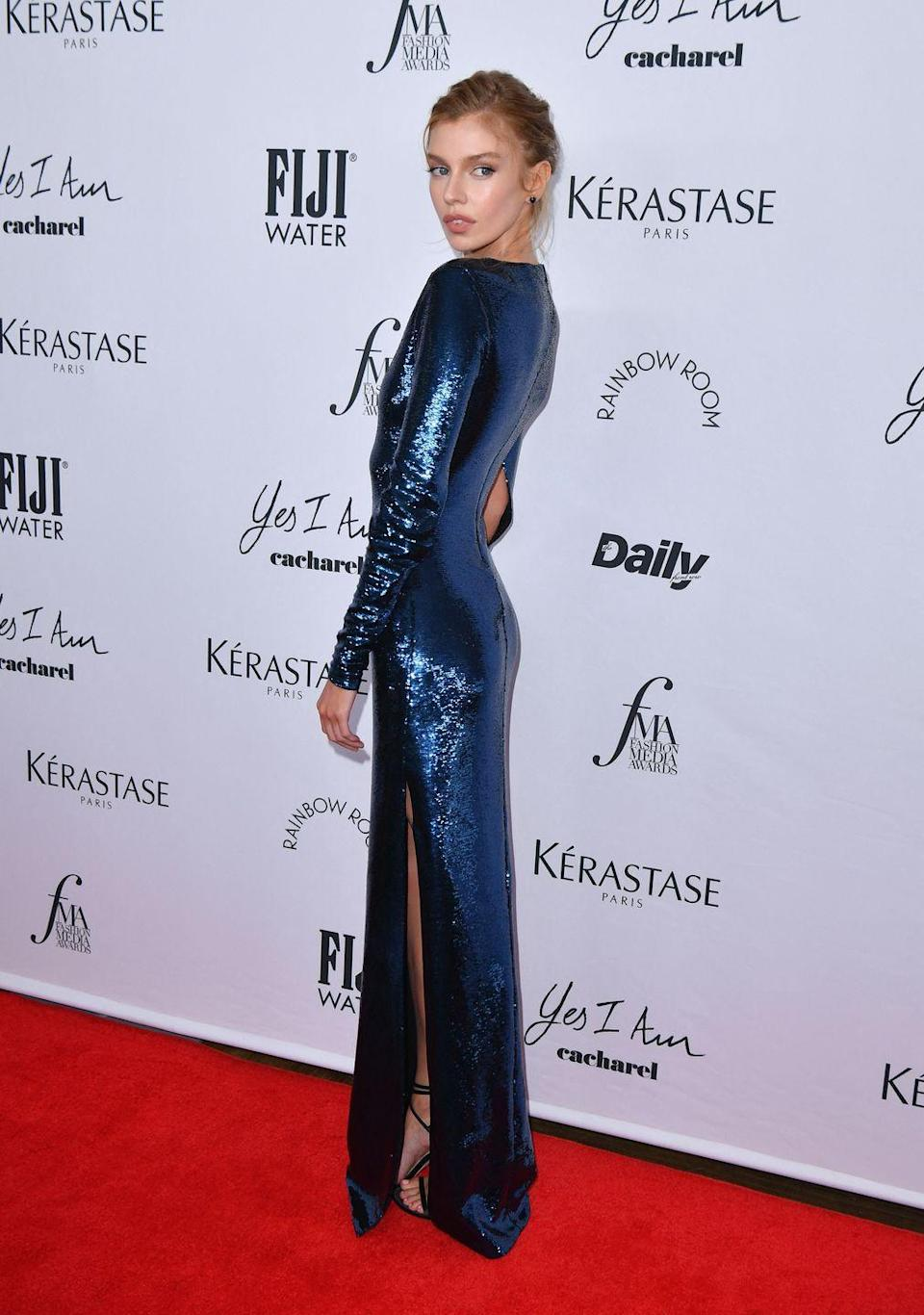 <p><strong>9 September</strong></p><p>Model Stella Maxwell wore an electric blue sequin Burberry gown to the event.</p>