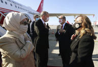 Turkey's President Recep Tayyip Erdogan, left, his wife Emine Erdogan, left, Ersin Tatar, second right, and his wife Sibel Tatar, greet each other during a welcome ceremony at Ercan Airport, in Nicosia, Northern Cyprus, Sunday, Nov. 15, 2020. Erdogan will attend ceremonies celebrating the 37th foundation anniversary of the Northern Turkish Cypriot Republic. (Turkish Presidency via AP, Pool)