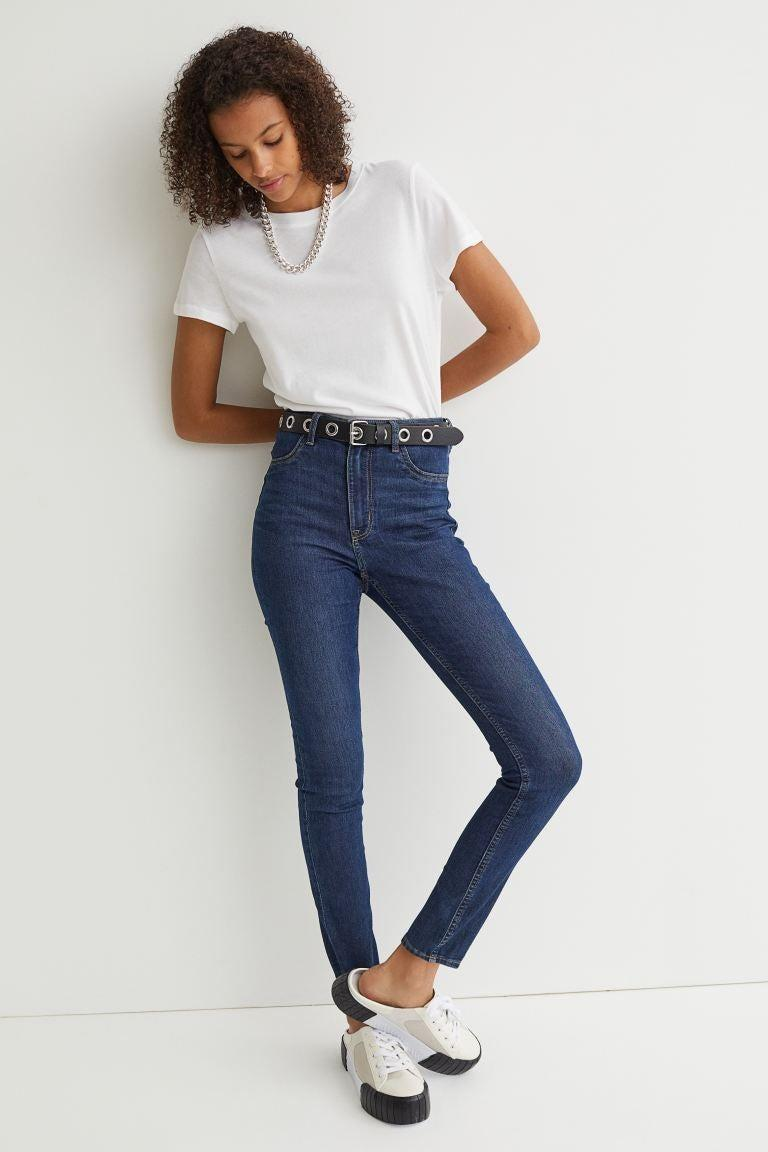 """<h2>H&M Super Skinny High Jeans</h2><br><em><strong>The Super High-Riser<br></strong></em><br>H&M is known for its ultra-affordable pricing, which is one of the biggest selling points for this $25 pair of jeans. Reviewers also love the tight fit (although many recommend sizing up for this reason) and the fact that they cover the belly button. When it comes to waists, this is about as high as it gets, folks!<br><br><strong>The Hype: </strong>4.3 out of 5 stars; 38 reviews on hm.com<br><br><strong>What They're Saying</strong>: """"Love the fit! The high-rise, length and tightness around the ankles is perfect."""" — Anonymous, hm.com reviewer<br><br><em>Shop</em> <strong><em><a href=""""https://www2.hm.com/en_us/productpage.0992197005.html"""" rel=""""nofollow noopener"""" target=""""_blank"""" data-ylk=""""slk:hm.com"""" class=""""link rapid-noclick-resp"""">hm.com</a></em></strong><br><br><strong>H&M</strong> Super Skinny High Jeans, $, available at <a href=""""https://go.skimresources.com/?id=30283X879131&url=https%3A%2F%2Fwww2.hm.com%2Fen_us%2Fproductpage.0992197005.html"""" rel=""""nofollow noopener"""" target=""""_blank"""" data-ylk=""""slk:H&M"""" class=""""link rapid-noclick-resp"""">H&M</a>"""