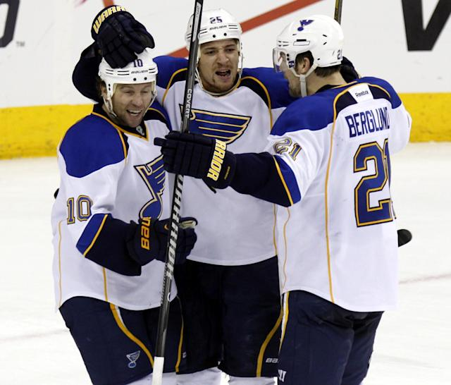 St. Louis Blues' Brenden Morrow (10), Chris Stewart (25) and Patrik Berglund (21), of Sweden, celebrate Stewart's goal against the Columbus Blue Jackets' in the third period of an NHL hockey game in Columbus, Ohio, Saturday, Dec. 14, 2013. St. Louis win 4-3 in overtime. (AP Photo/Paul Vernon)