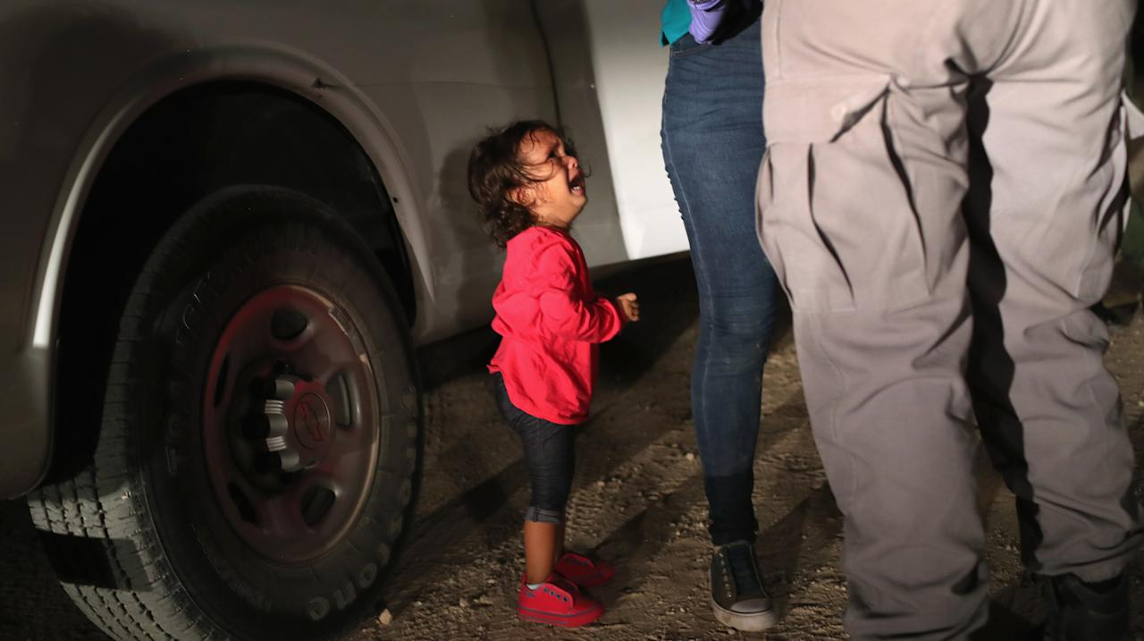 "<p>A two-year-old Honduran asylum seeker cries as her mother is searched and detained near the U.S.-Mexico border on June 12, 2018 in McAllen, Texas. The asylum seekers had rafted across the Rio Grande from Mexico and were detained by U.S. Border Patrol agents before being sent to a processing center for possible separation. Customs and Border Protection (CBP) is executing the Trump administration's ""zero tolerance"" policy towards undocumented immigrants. U.S. Attorney General Jeff Sessions also said that domestic and gang violence in immigrants' country of origin would no longer qualify them for political asylum status. (Photo from John Moore/Getty Images) </p>"