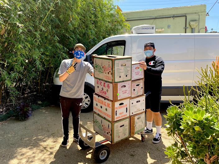 Kyle Tsukahira and David Mey of API Forward Movement's Food Roots program pack CSA bags out of their office in Downtown Los Angeles. (Ronnie Han)