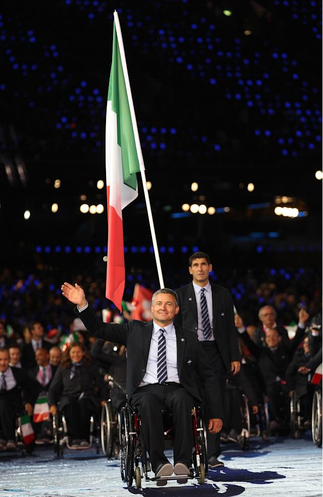 LONDON, ENGLAND - AUGUST 29: Shooter Oscar De Pellegrin of Italy carries the flag during the Opening Ceremony of the London 2012 Paralympics at the Olympic Stadium on August 29, 2012 in London, England. (Photo by Dan Kitwood/Getty Images)