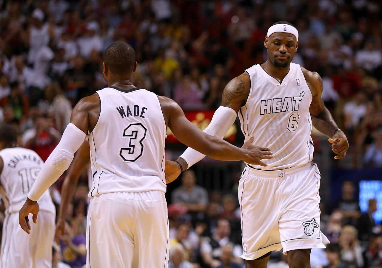 MIAMI, FL - FEBRUARY 10: Dwyane Wade #3 and LeBron James #6 of the Miami Heat high five during a game against the Los Angeles Lakers at American Airlines Arena on February 10, 2013 in Miami, Florida.  (Photo by Mike Ehrmann/Getty Images)
