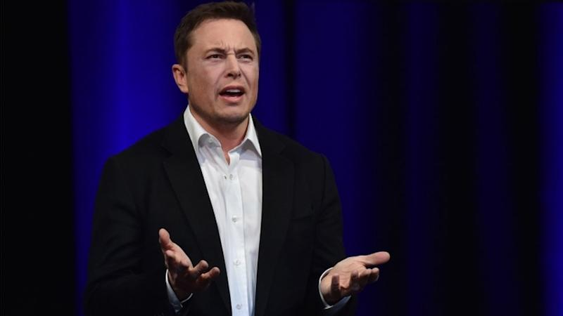 Elon Musk looks annoyed and gesticulates with his hands